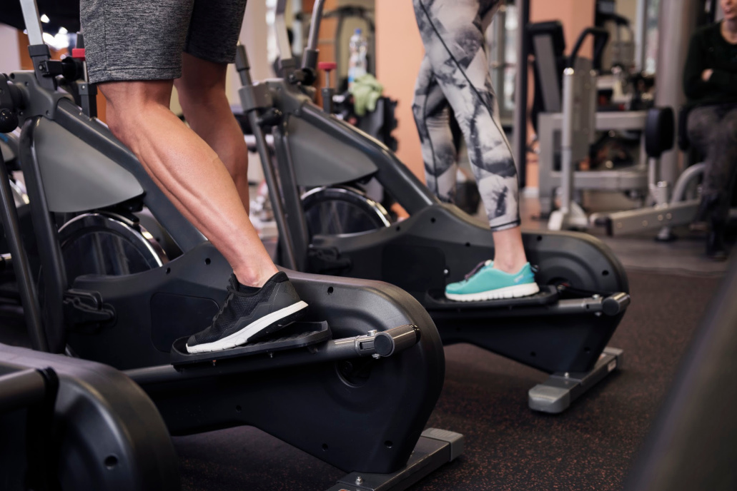 Strong legs of exercising couple